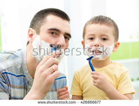 stock-photo-father-shaving-in-the-mirror-kid-son-imitates-father-426866677