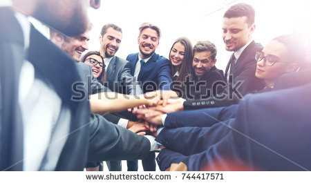 stock-photo-large-business-team-showing-unity-with-their-hands-together-744417571