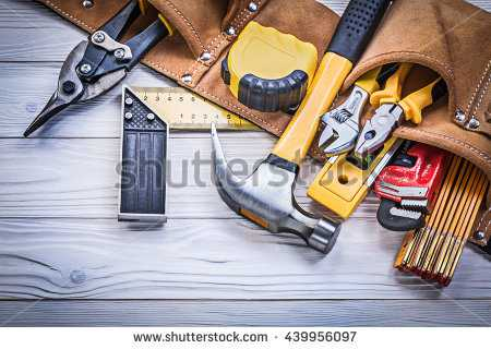 stock-photo-leather-tool-belt-with-construction-tooling-on-wooden-board-maintenance-concept-439956097